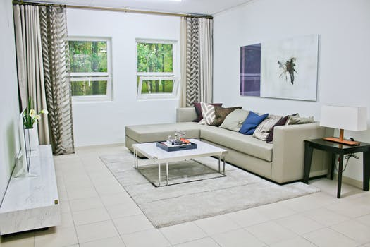 Gray Leather Sectional Sofa With White Coffee Table