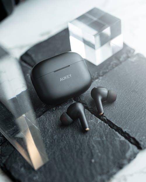 Black Amazon Echo Dot on Gray Textile