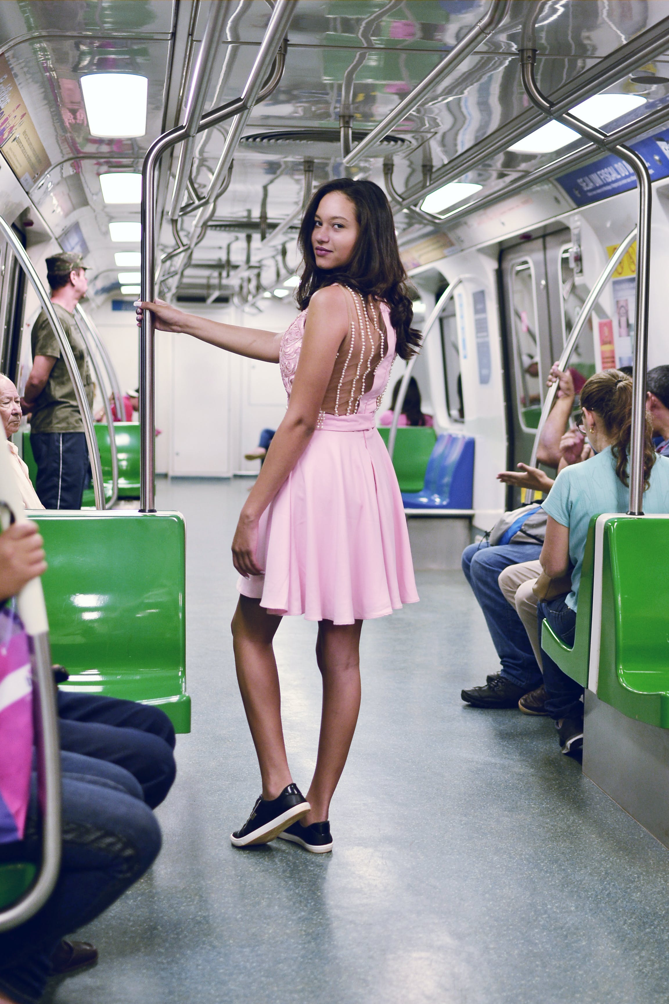 Woman Wearing Pink Sleeveless Dress Inside the Train