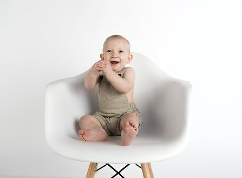 Baby Sitting on White Chair