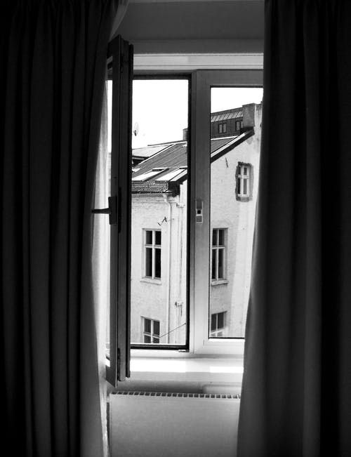 Grayscale Photography of Window Curtain and Window