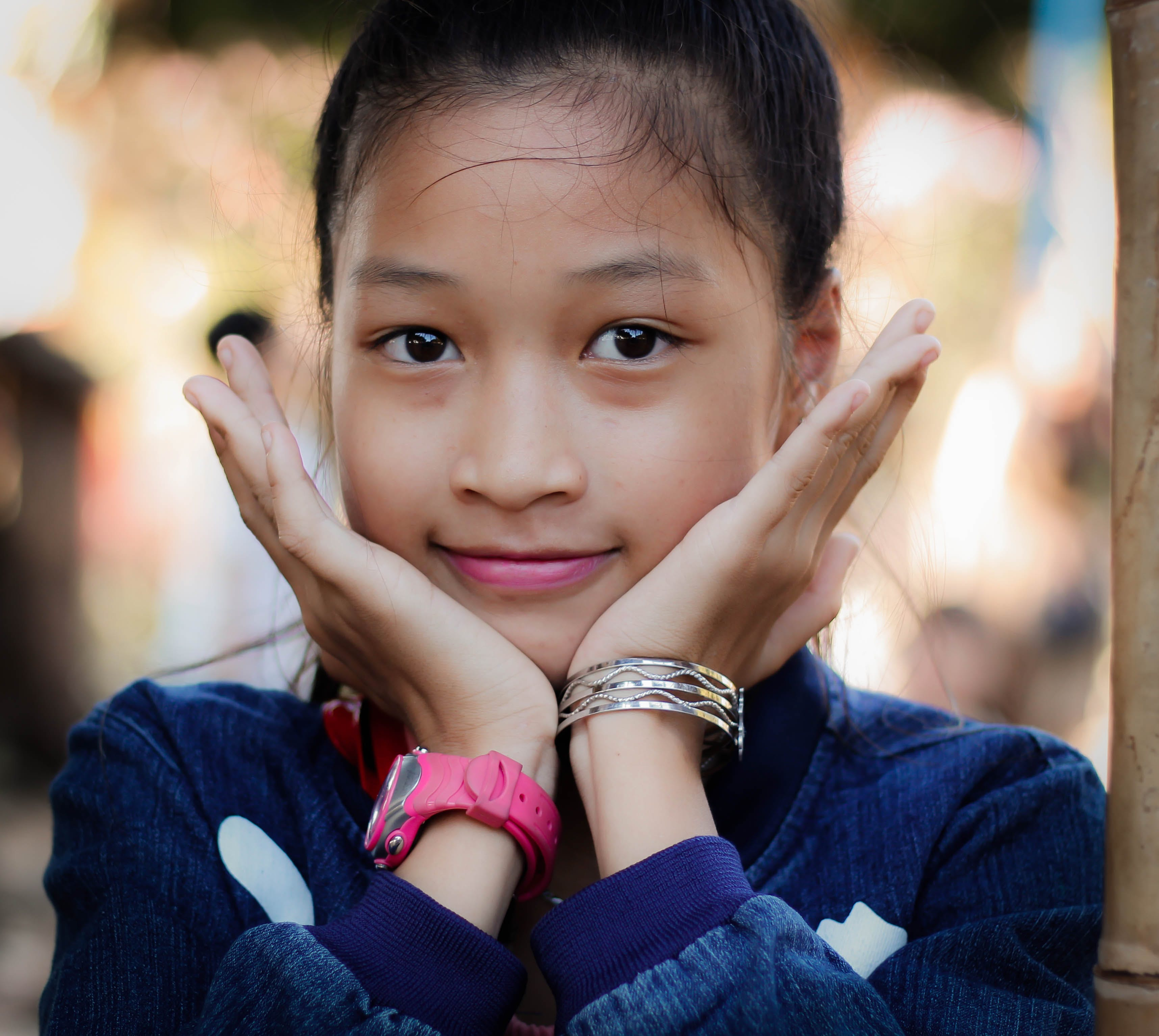 Girl Wearing Blue Long-sleeved Top Resting Face On Hands