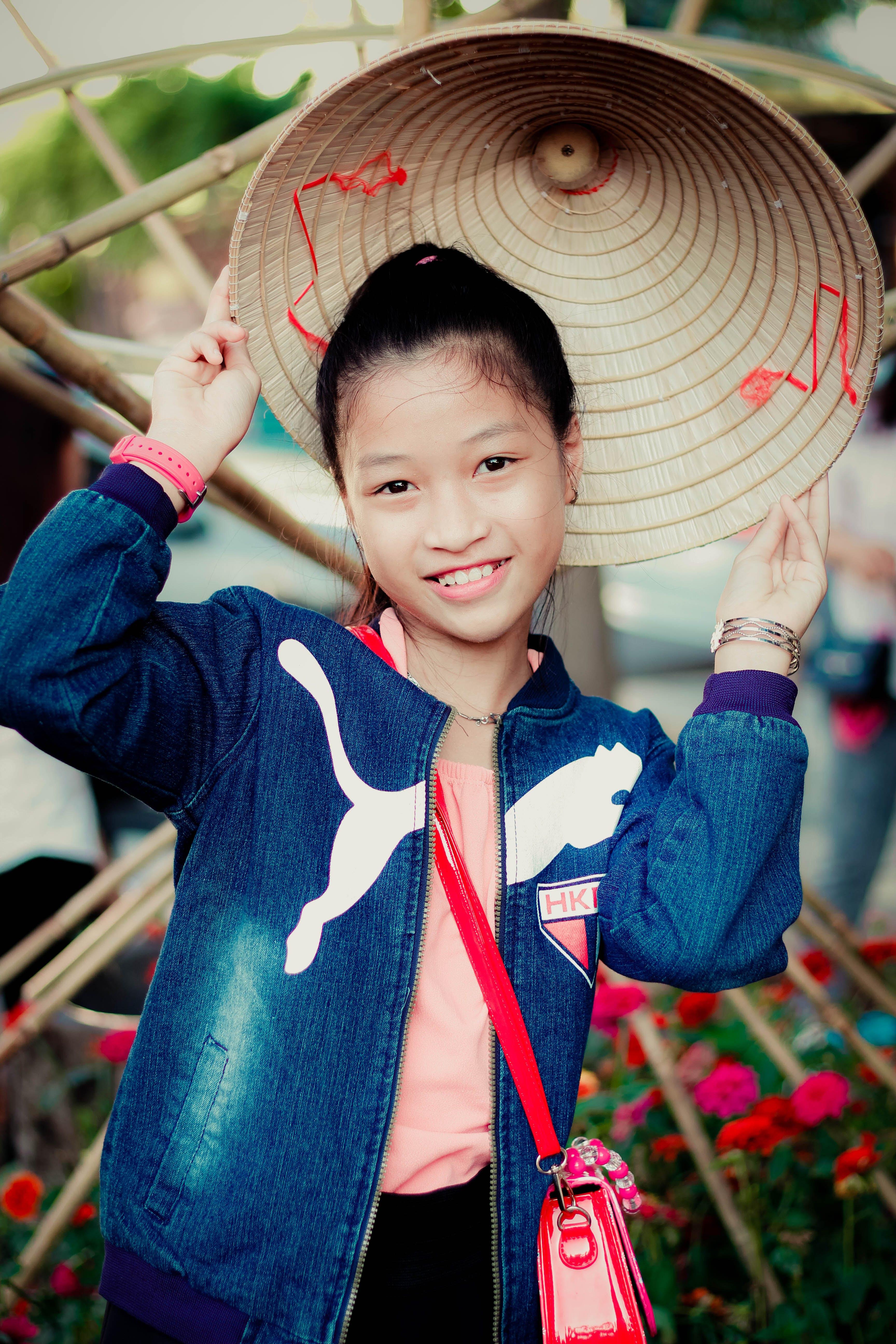 Girl In Blue Puma Denim Zip-up Jacket Smiling