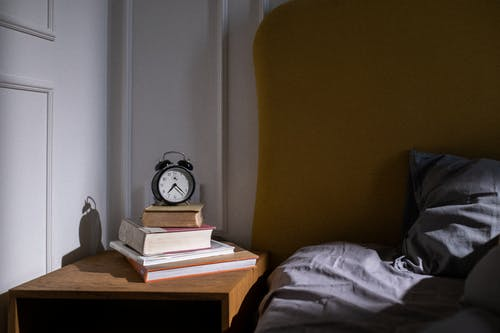 Free stock photo of alarm, bed, bedroom interior