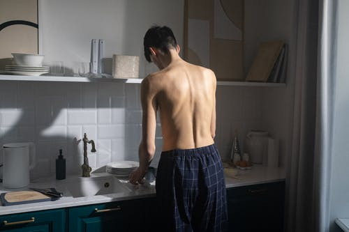 Free stock photo of adult, boxer shorts, coffee making