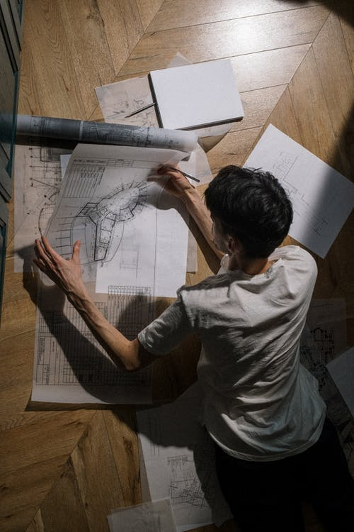 Adult man laying on floor and holding a drawing