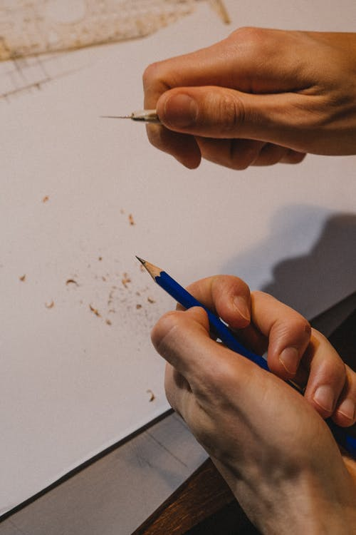 Close up on mans hands tempering pencil
