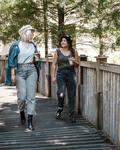 Two young girls walking and talking