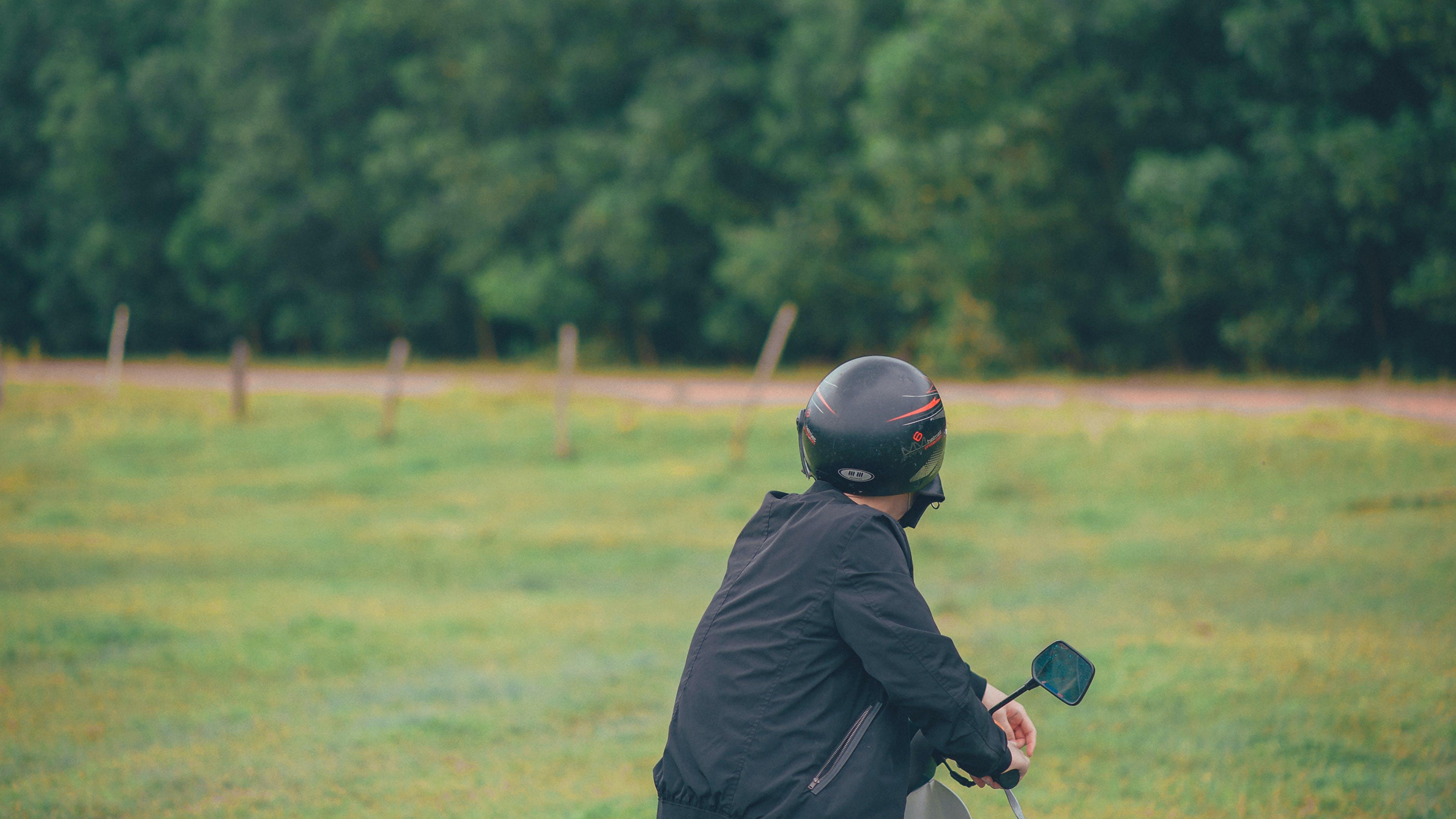 Photo of a Man Wearing Black Helmet
