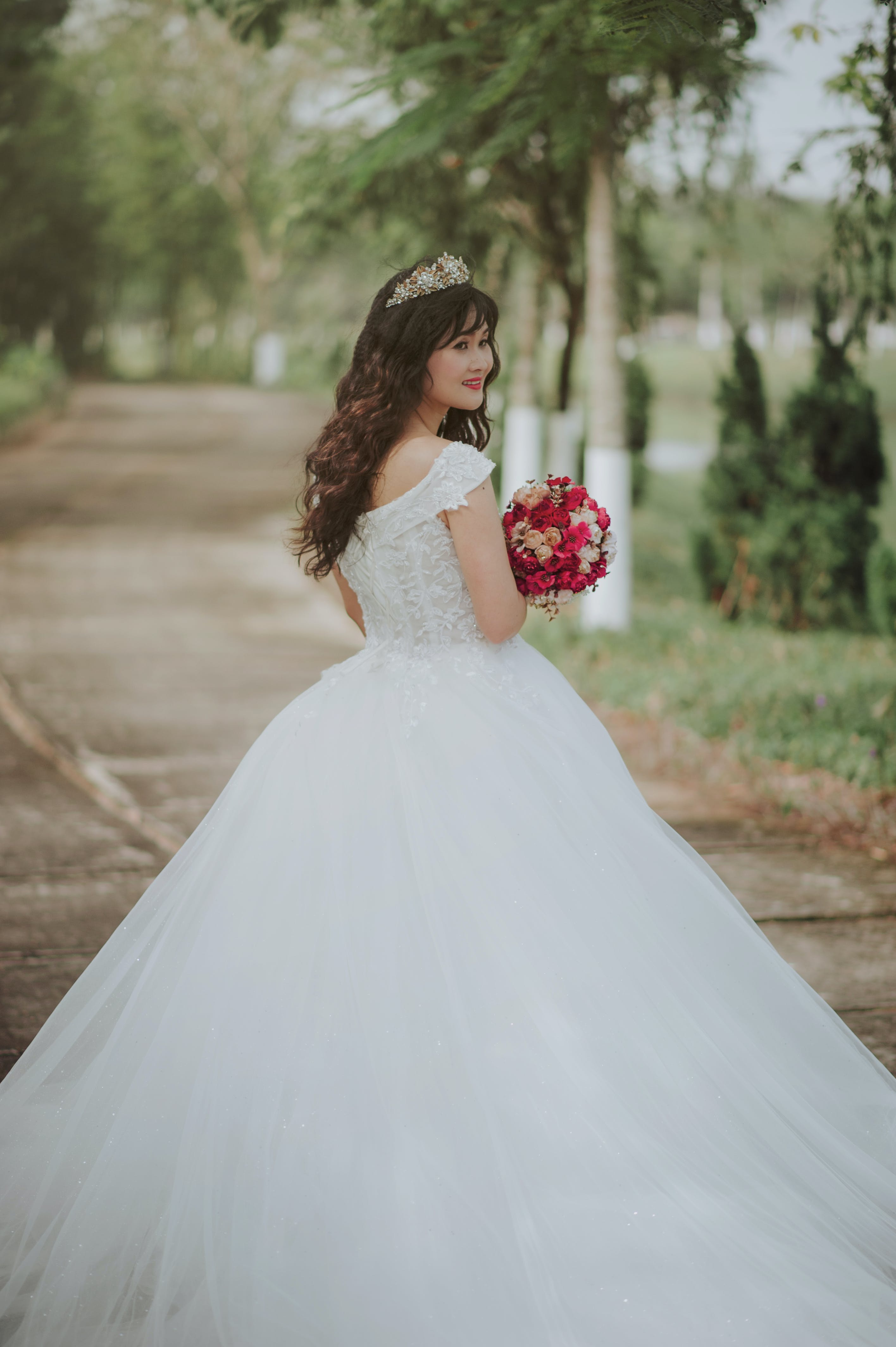 Photo of a Woman in Her Wedding Dress
