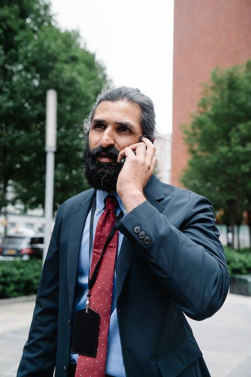 Man in full suit talking on phone