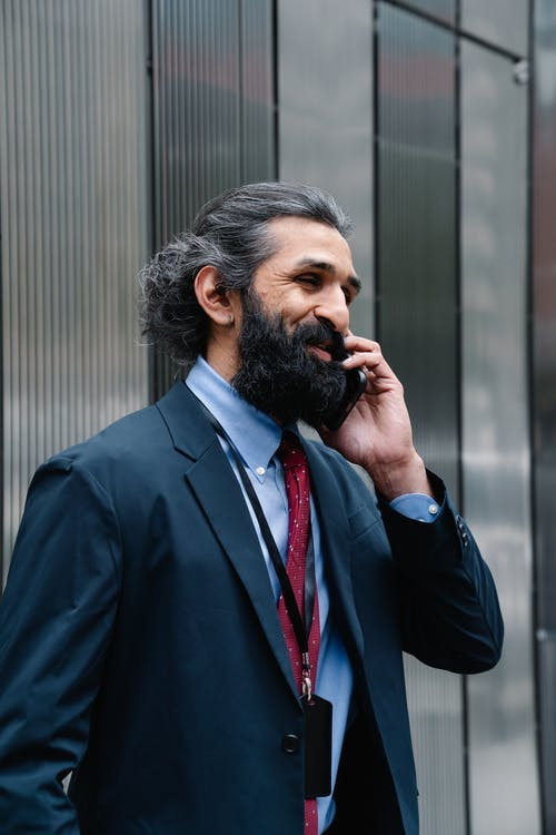 Smiling man in suit talking on the phone