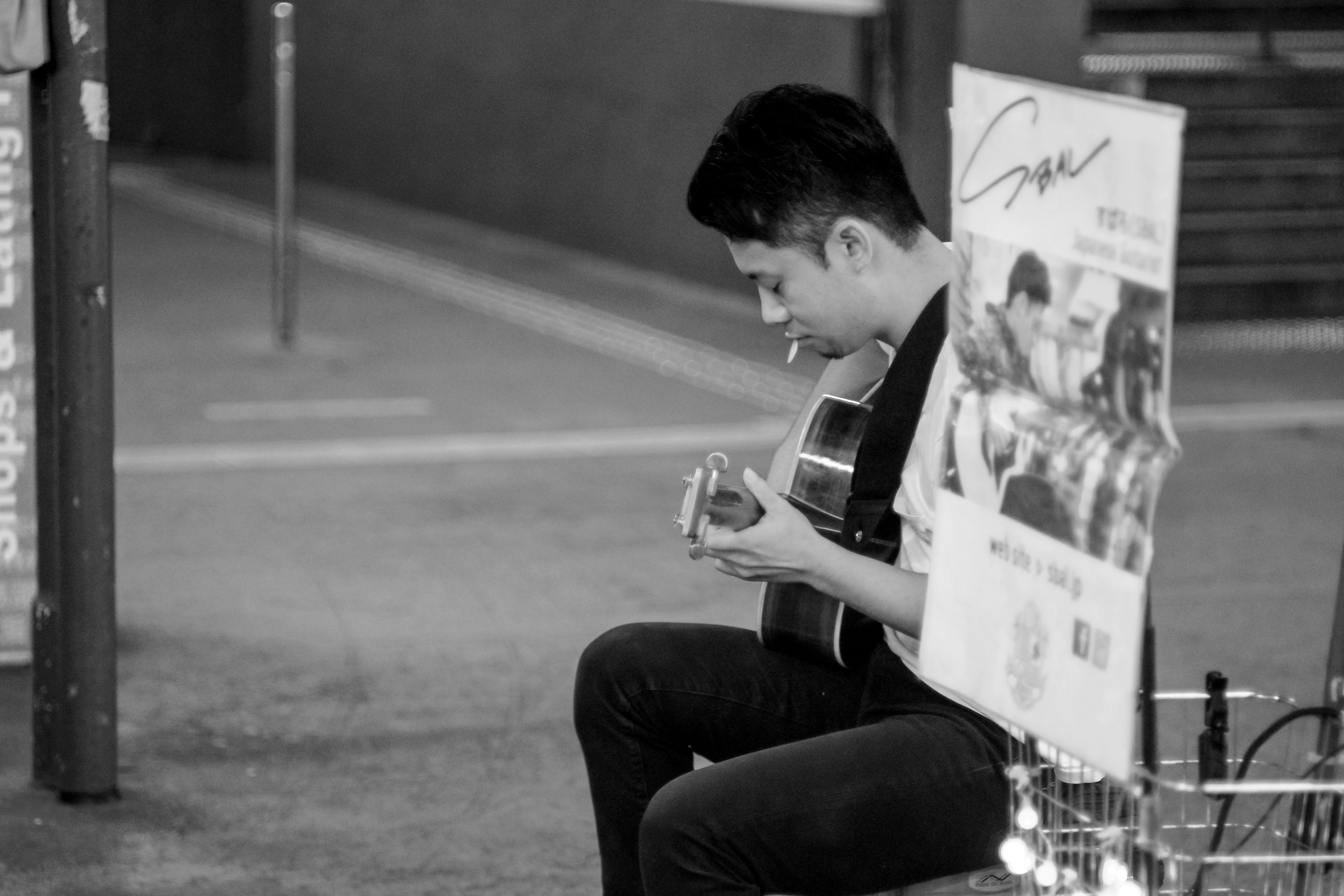Man Playing Acoustic Guitar Grayscale Photography