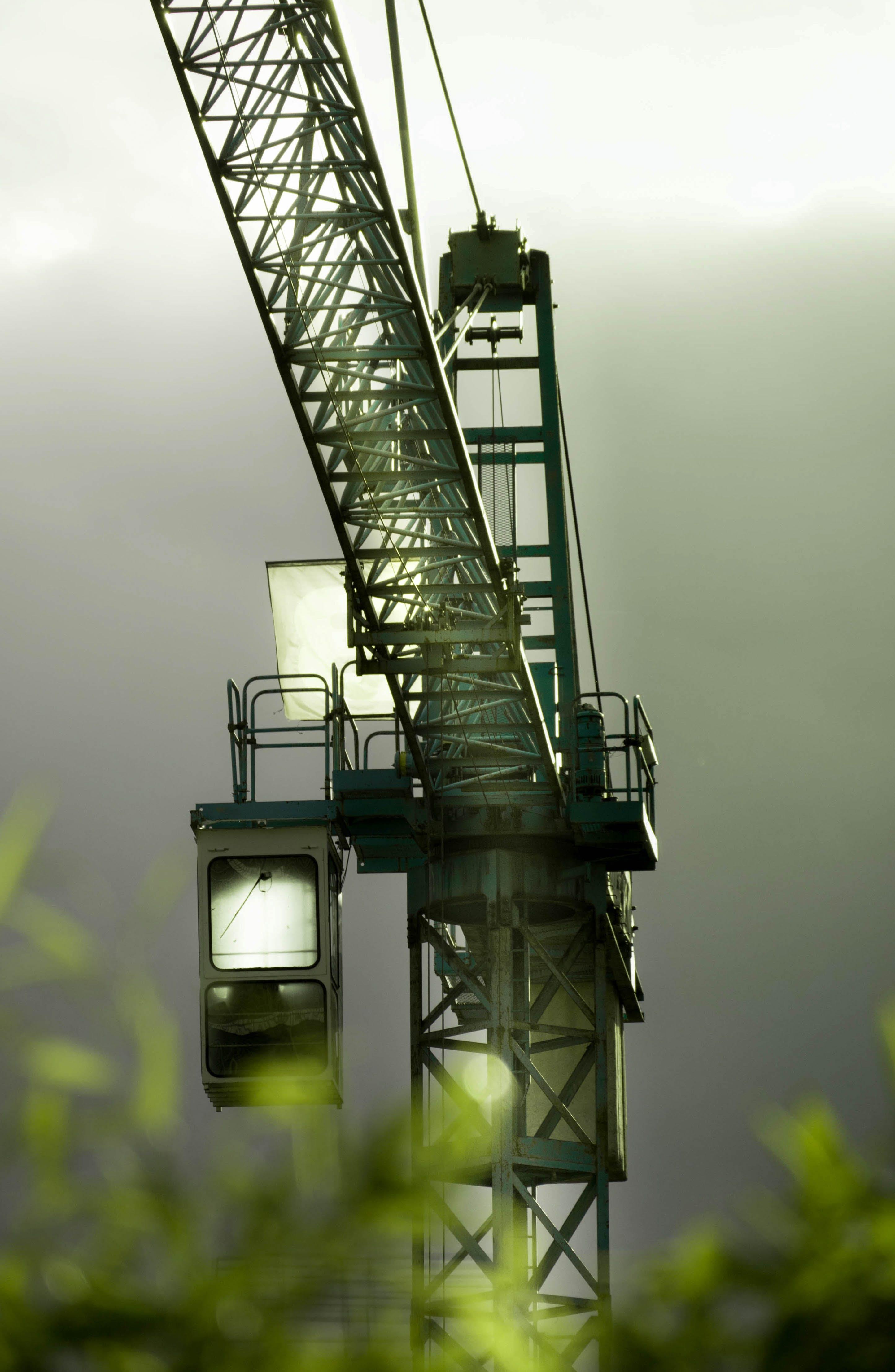 Tilt Lens Photography of Black Steel Crane