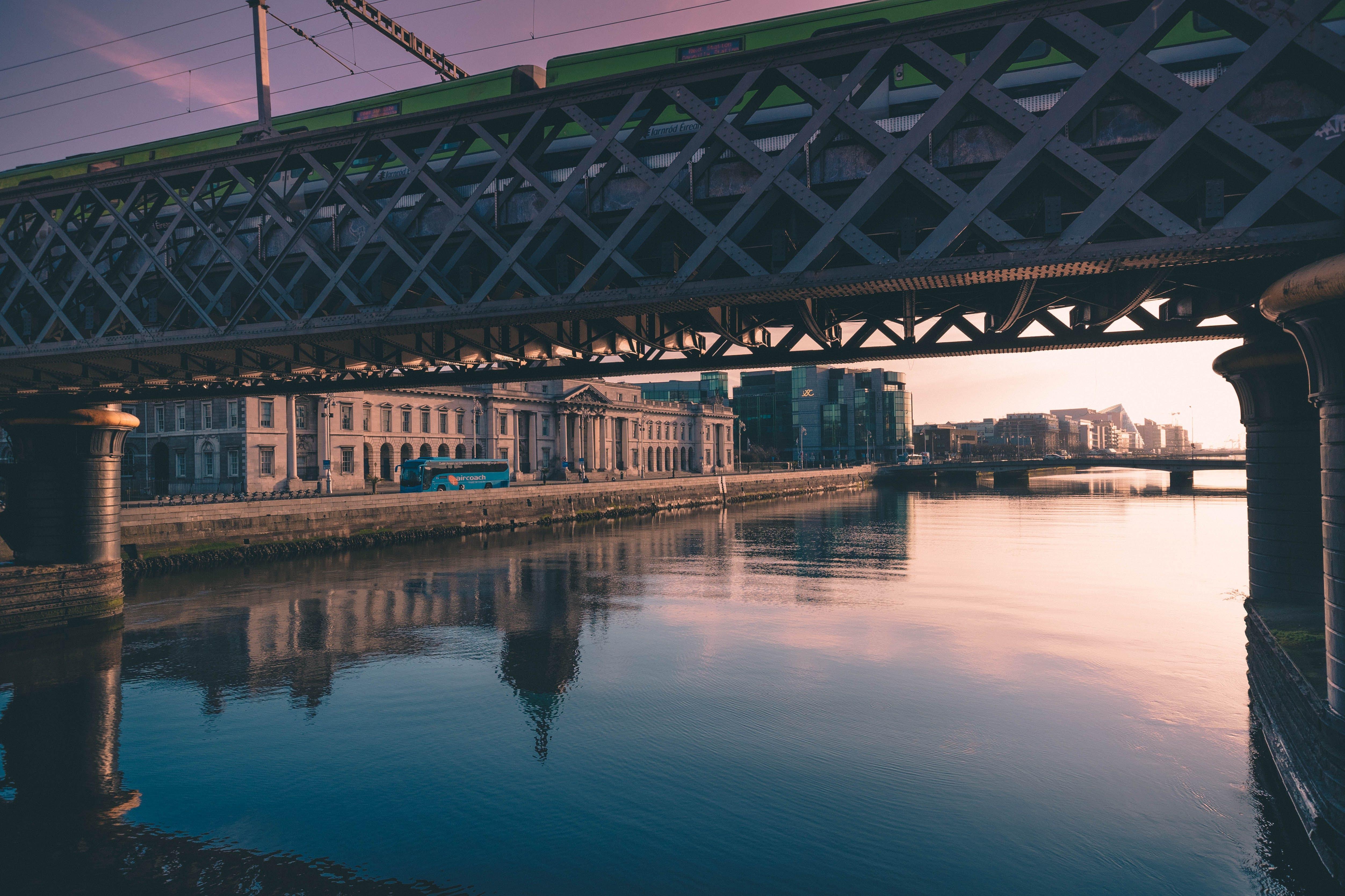 Gray Metal Bridge Near Brown Concrete Building