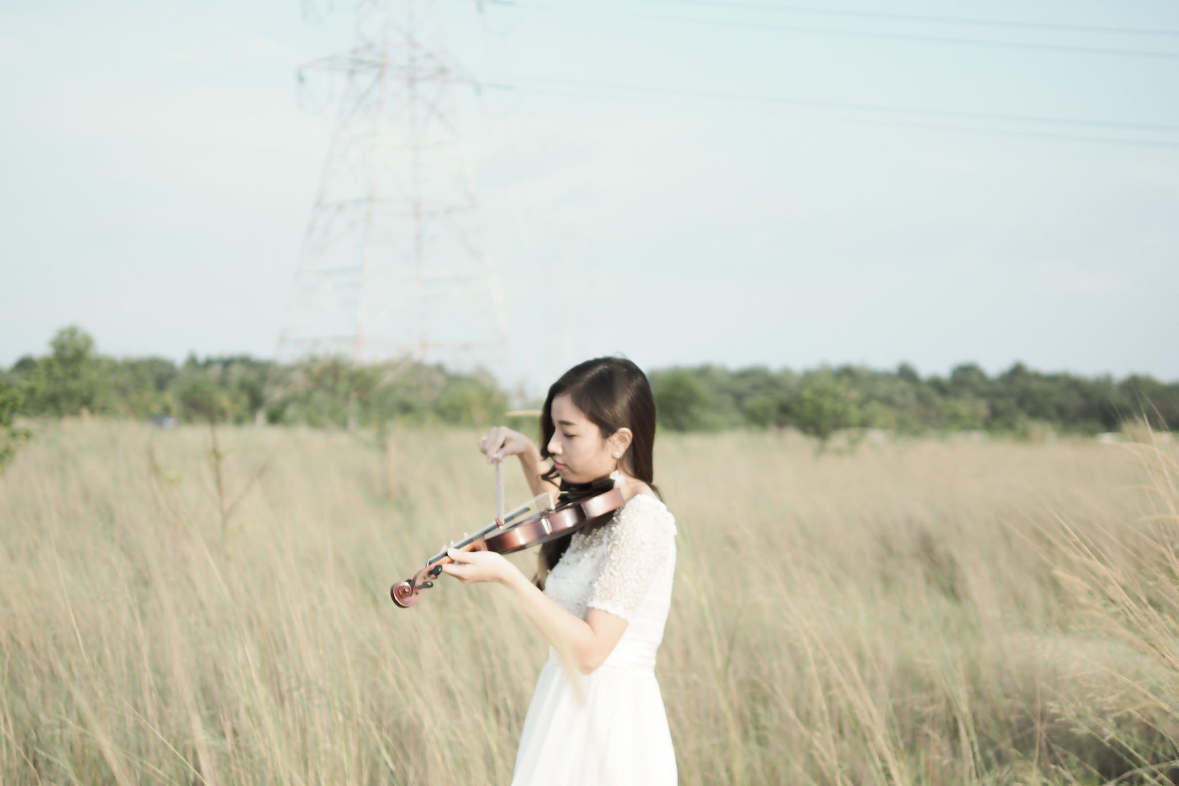 Woman Wearing White Dress Playing Violin