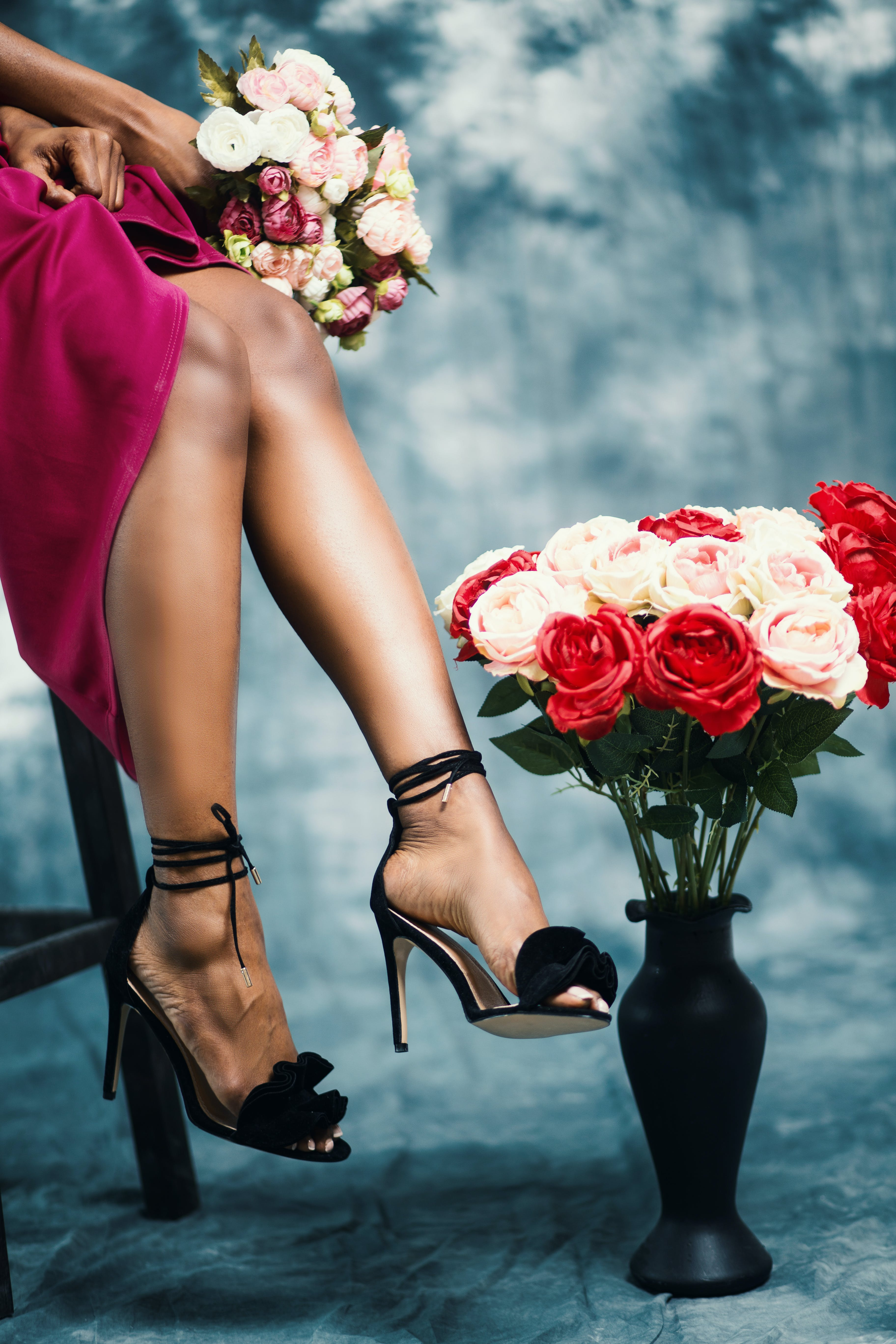 Red and Pink Rose Flower Bouquet at Woman's Hand