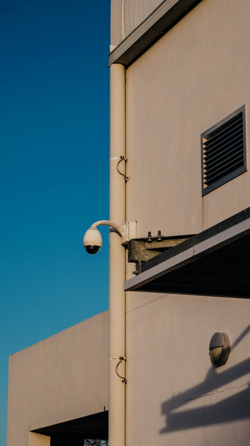 White CCTV Camera on the Wall