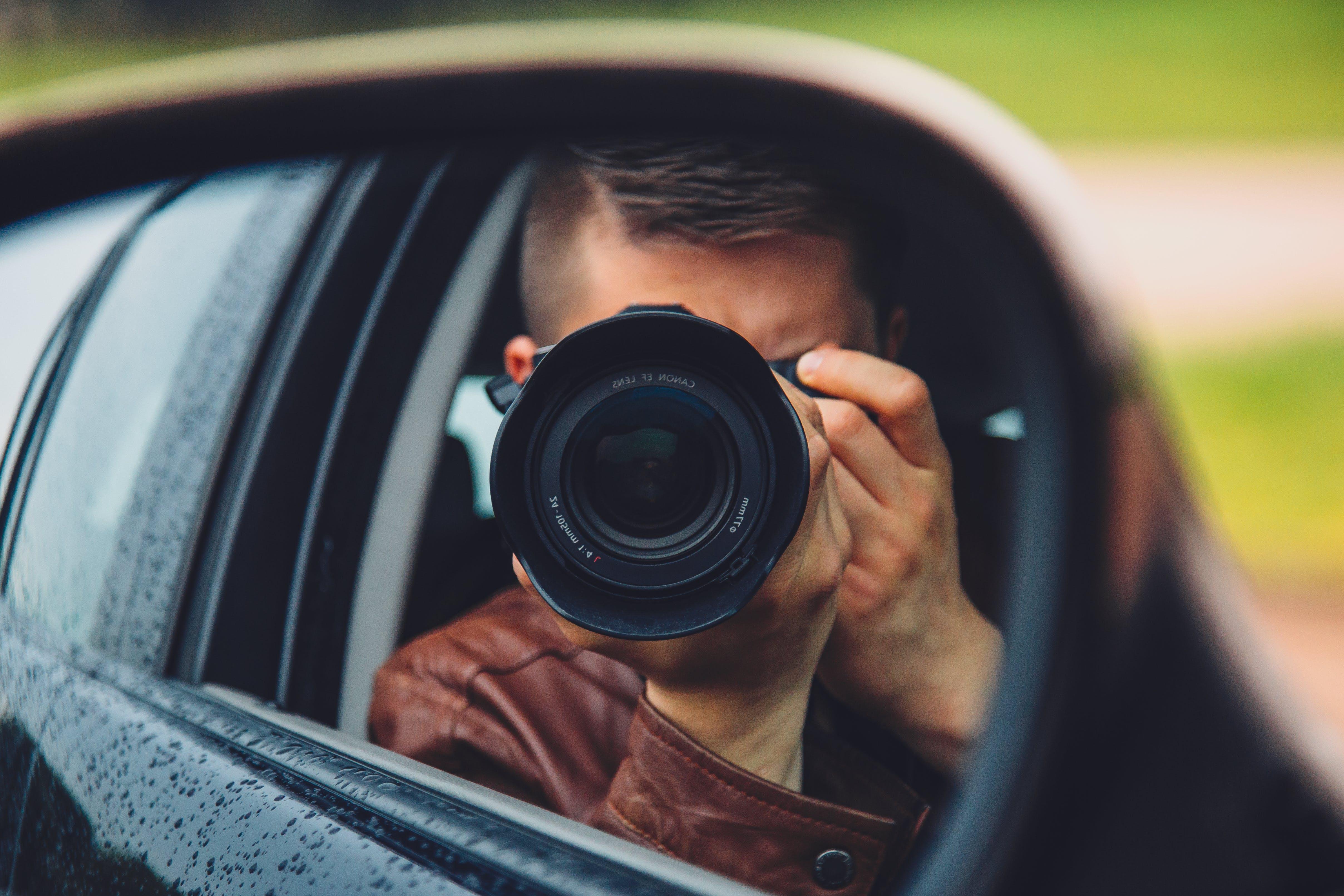 Kostenloses Stock Foto zu auto, dslr, fotograf, hand