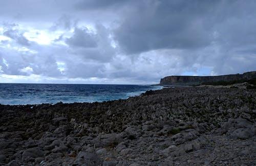 Photos gratuites de bord de mer, cailloux, ciel, eau