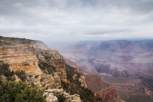 Rocky Mountain Under Cloudy Sky