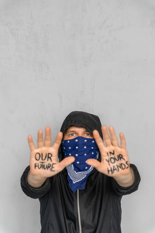 Person in Black Long Sleeve Shirt Covering Face With Hands