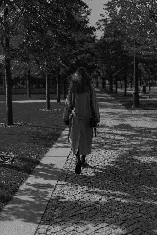 Back View Of A Woman Walking in Grayscale Photography