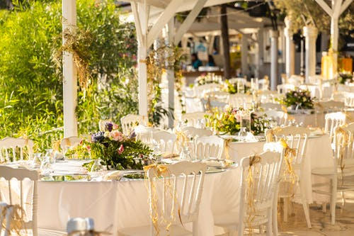 White Table Cloth With White Table Cloth and Chairs