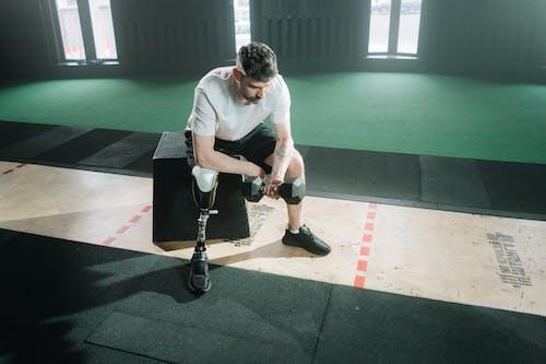 Foto d'estoc gratuïta de assegut, atleta, cama protésica