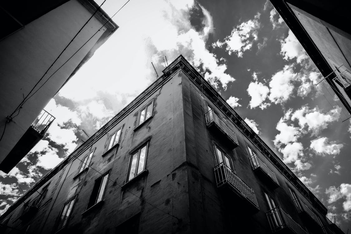 Grey Scale Photo of Building during Daytime