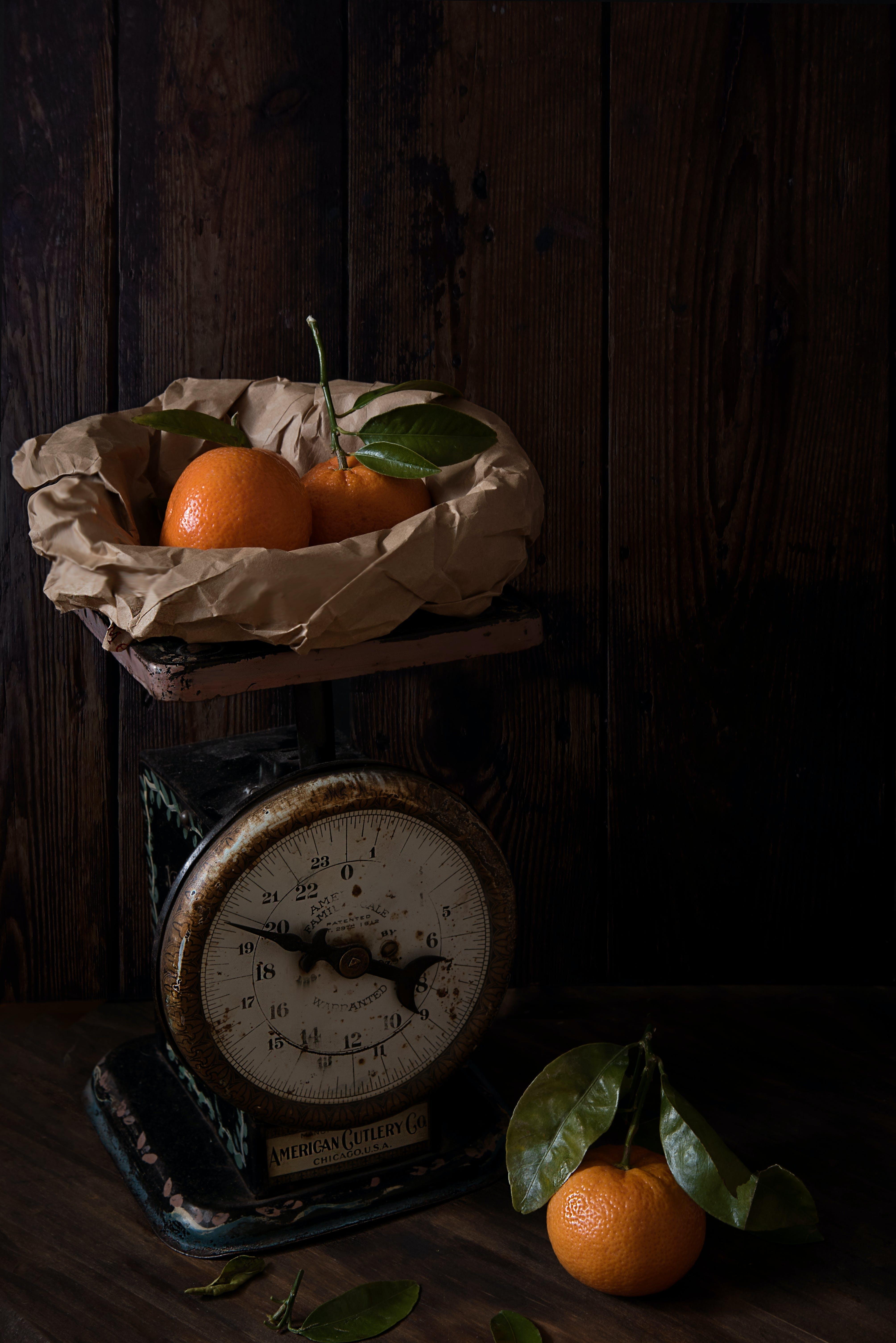 Three Orange Fruits and Analog Scale