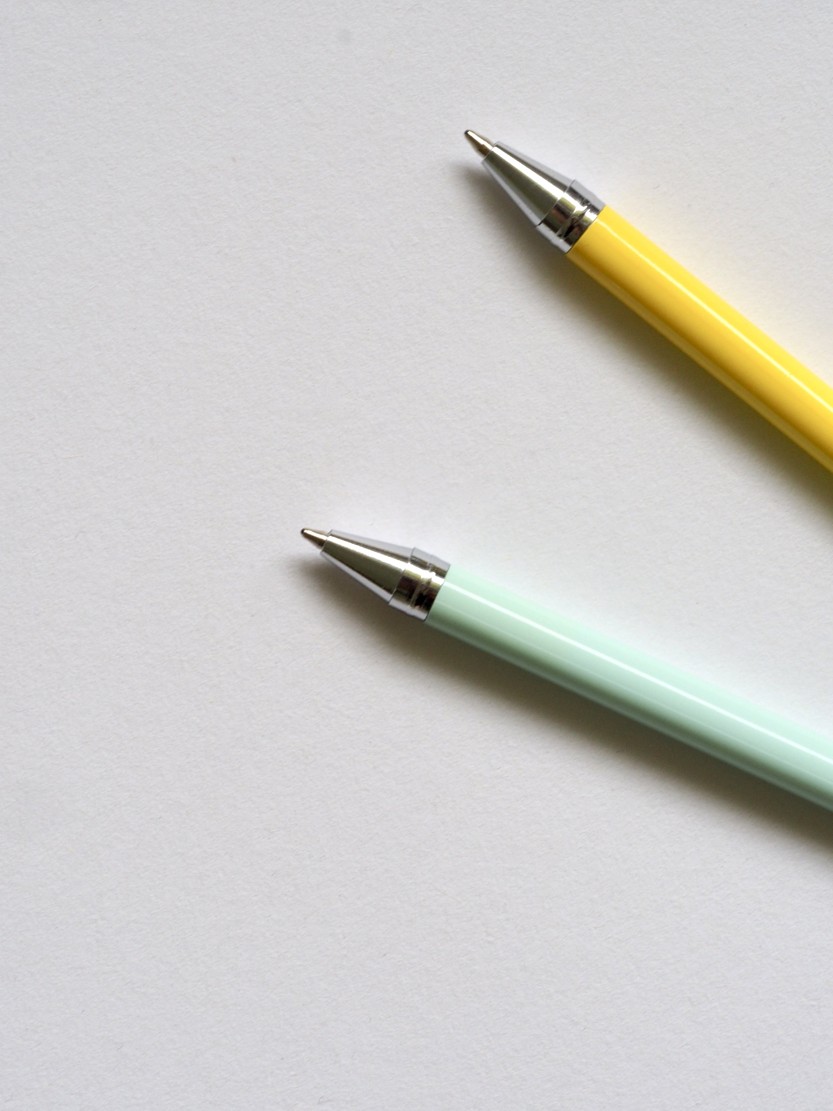 Photo of Teal and Yellow Point Pens