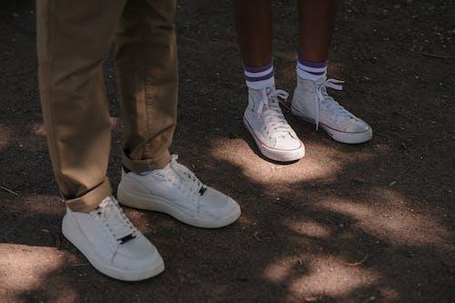 Legs of two teenagers