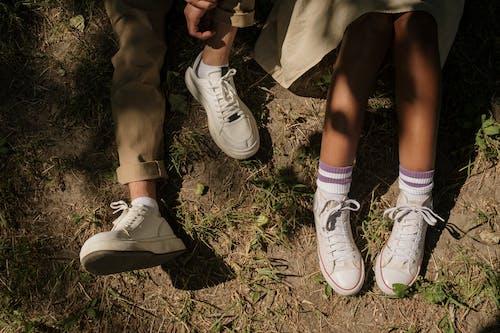 Legs of teenagers sitting