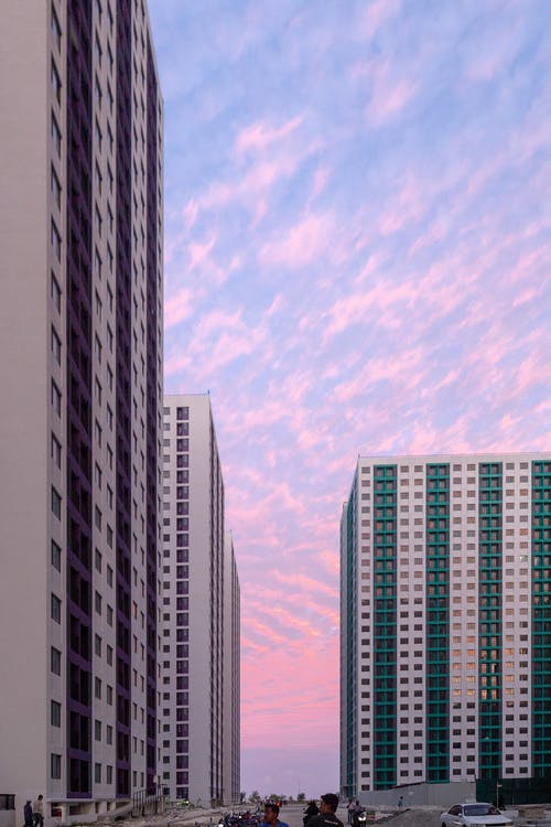 White and Brown High Rise Buildings Under Blue Sky