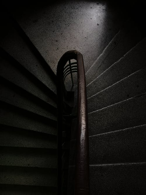 Black Metal Spiral Staircase With Brown Wooden Railings