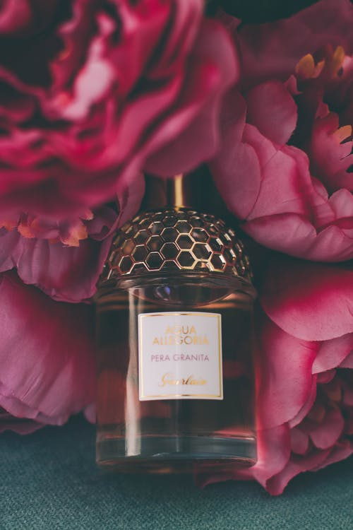 Perfume Bottle Surrounded by Flowers