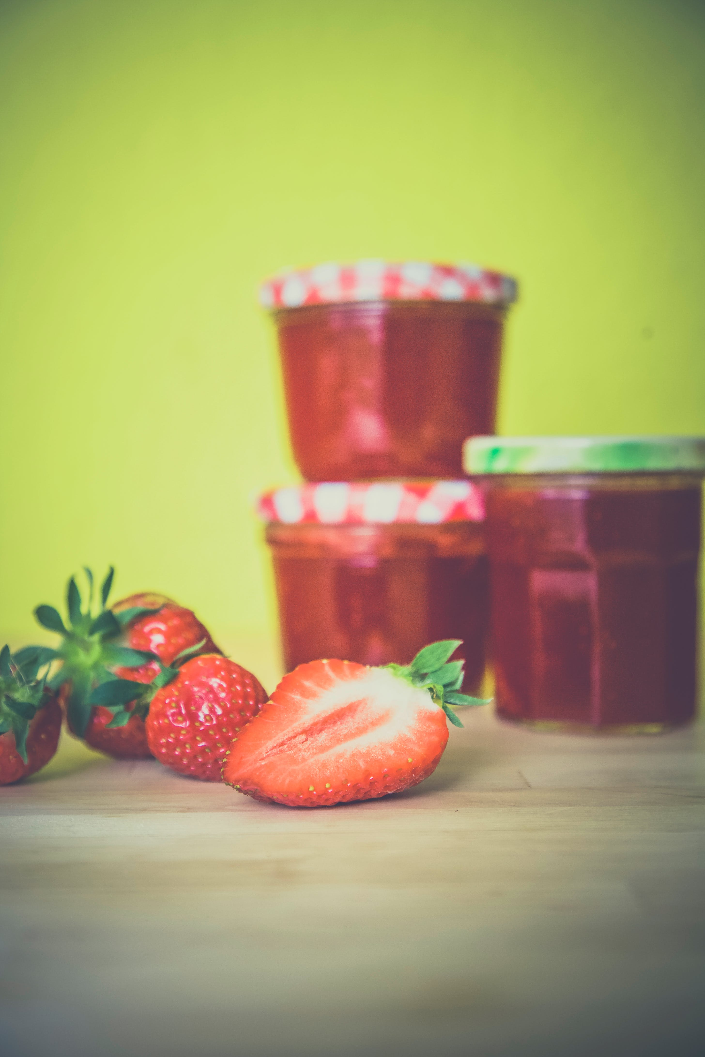 Strawberry Near Red Jar on Wooden Surface