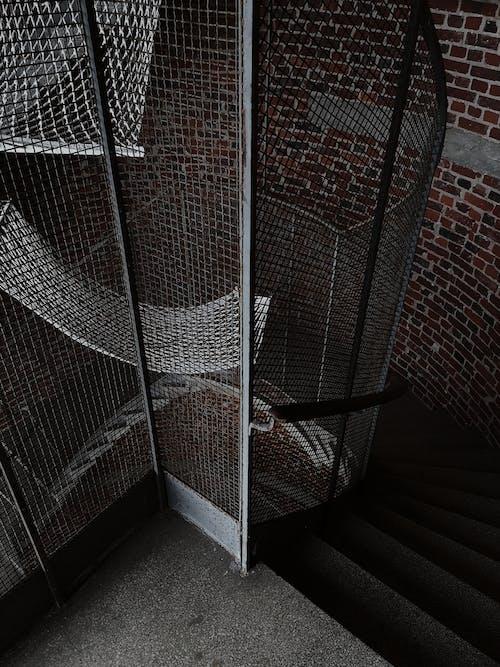 White Metal Frame Near Brown Brick Wall