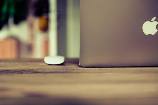 Silver Macbook on Brown Wooden Surface