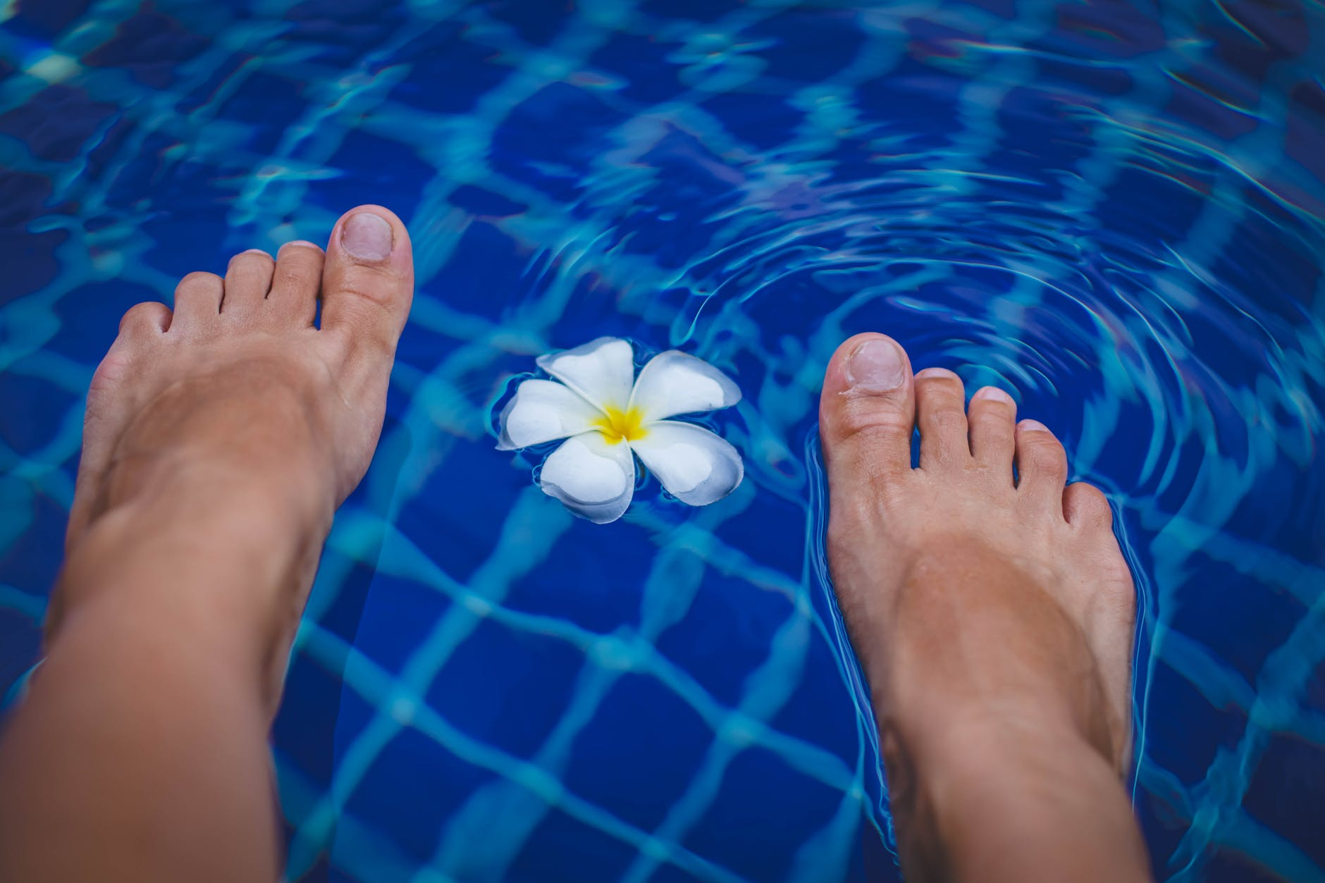 feet on the water with flower