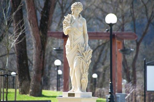Woman Statue Beside Street Light