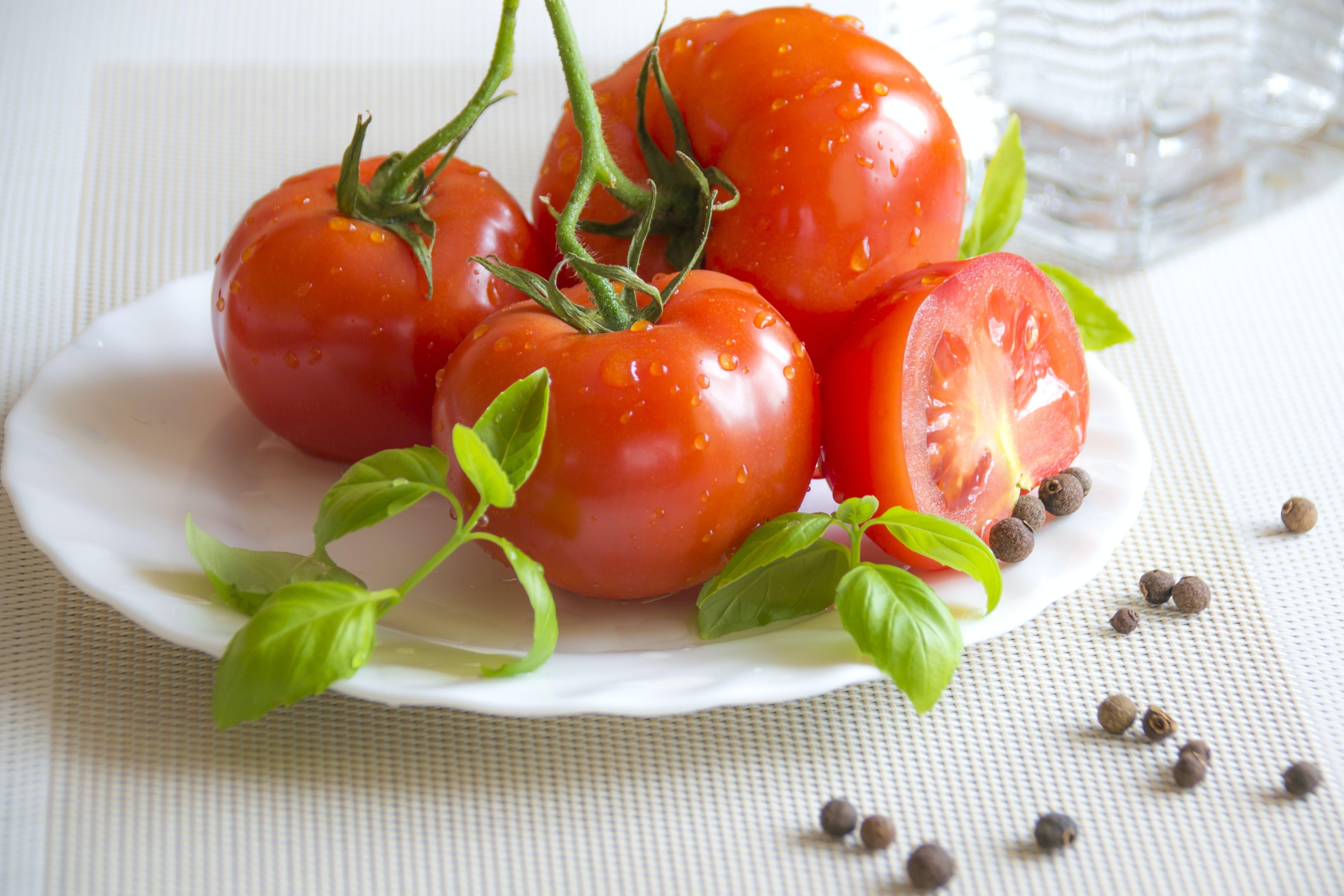 Tomato Top of White Ceramic Plate