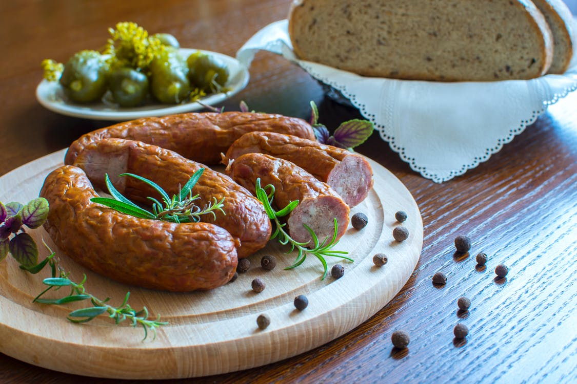 Cooked Sausages on White Plate