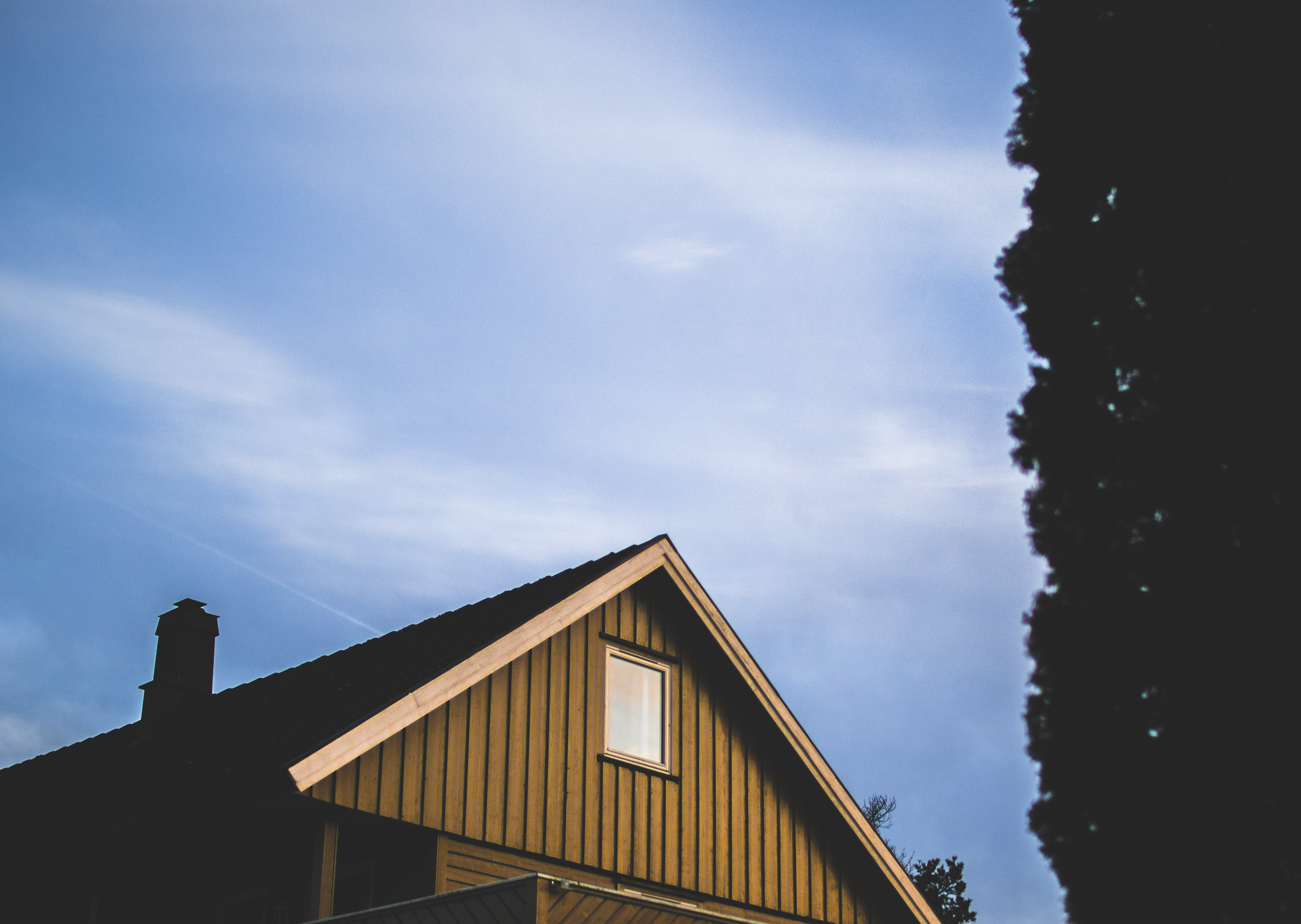 Brown Wooden House Under Blue Sky at Daytime