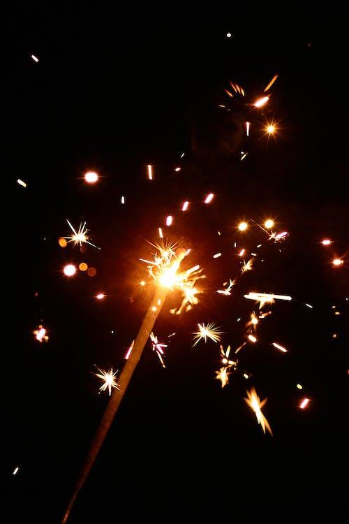 Flashing sparkles on black background