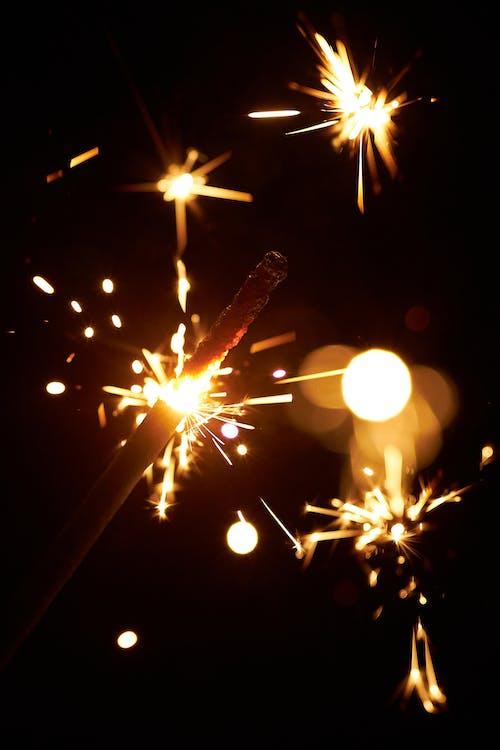 Lit sparkler giving dazzling sparkles