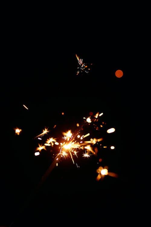 Sparks shining around sparkler stick