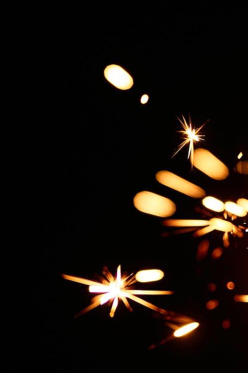 Sparks like stars in black sky