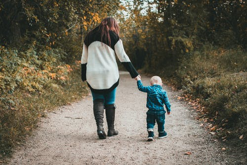 Mother walking with baby son